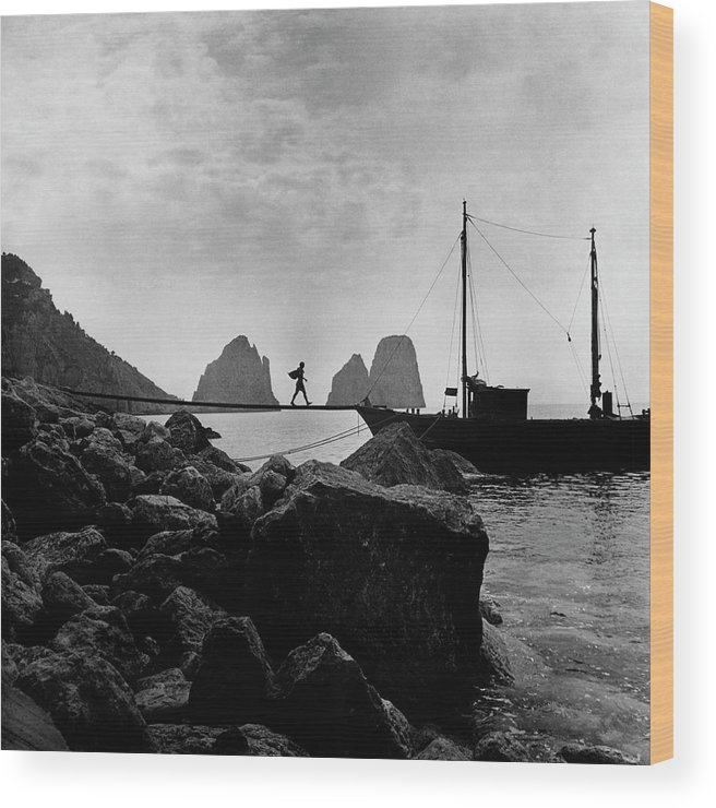 Capri Wood Print featuring the photograph A Boat Docked At Capri by Clifford Coffin