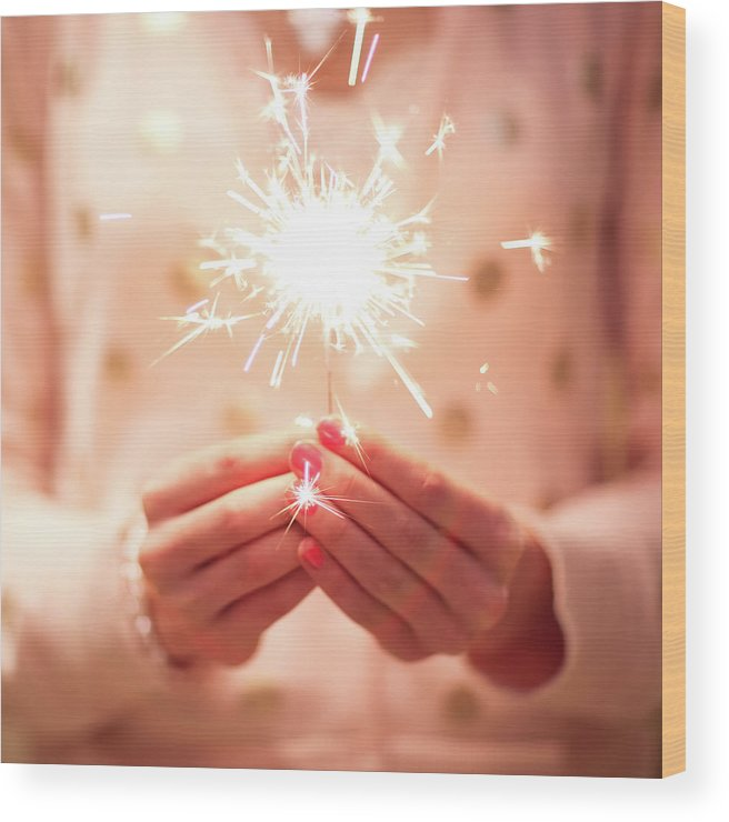 Firework Display Wood Print featuring the photograph Girl Holding Small Sparkler by Sasha Bell