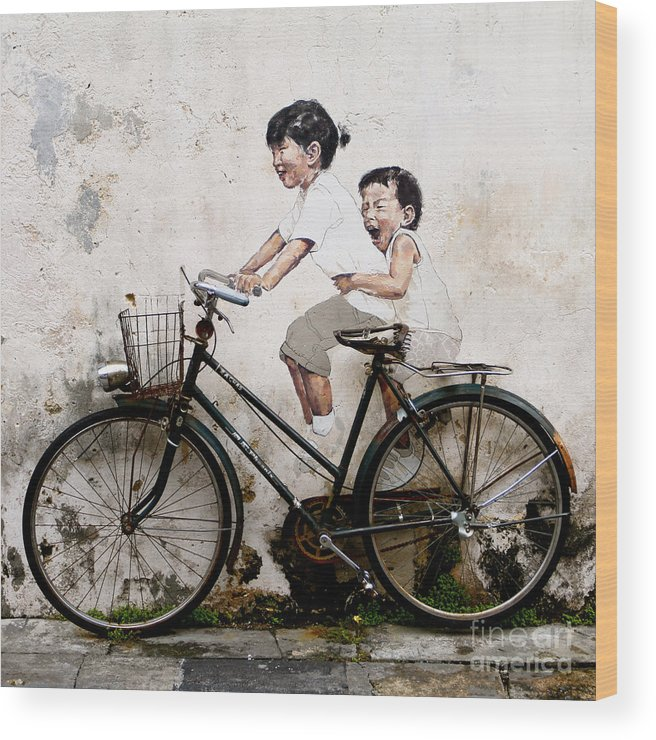 Little Children On A Bicycle Wood Print featuring the photograph Little Children on a Bicycle by Donald Chen