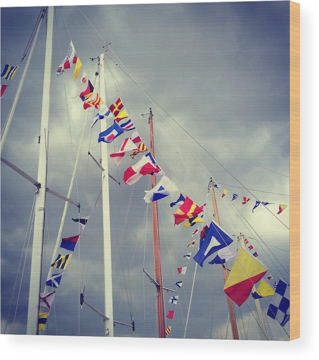 Pole Wood Print featuring the photograph Marine Signal Flags On Mast Against A by Jodie Griggs
