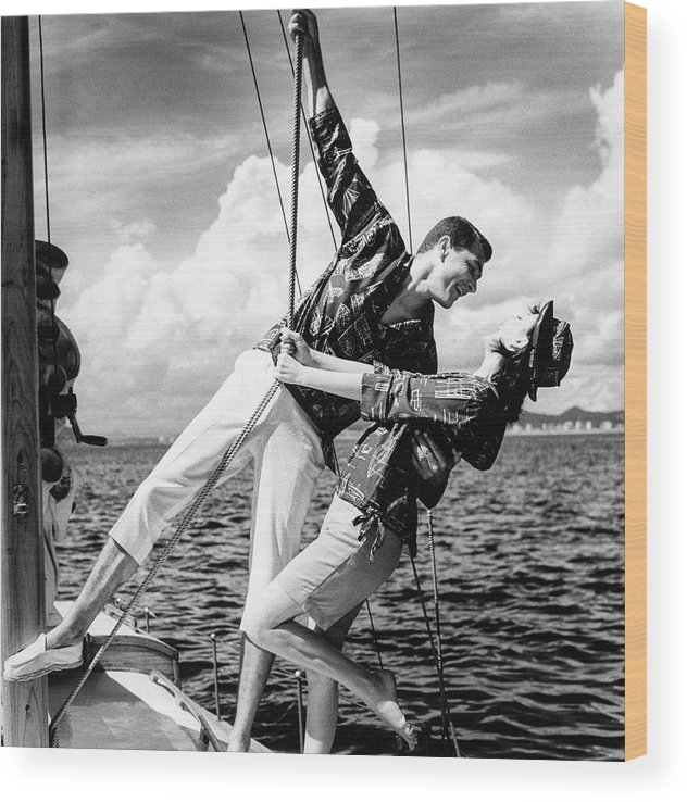 Outdoors Wood Print featuring the photograph Models Wearing A Bennett Shirts On A Sailboat by Richard Waite