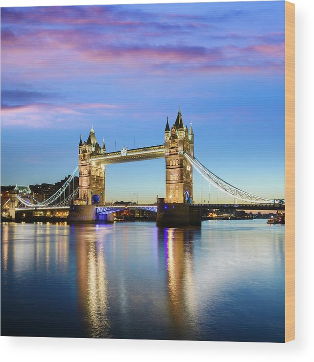 Downtown District Wood Print featuring the photograph Tower Bridge Located In London by Deejpilot