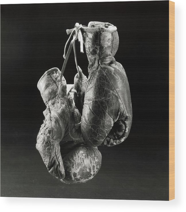 Fist Wood Print featuring the photograph A Worn Boxing Gloves by Henri Silberman