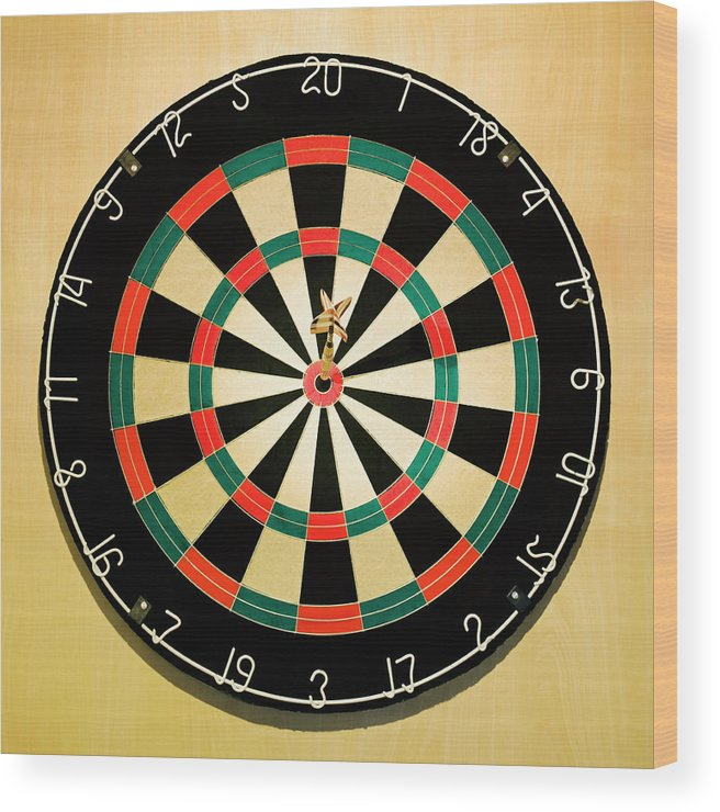 Expertise Wood Print featuring the photograph Dart In Bulls Eye On Dart Board by Fuse