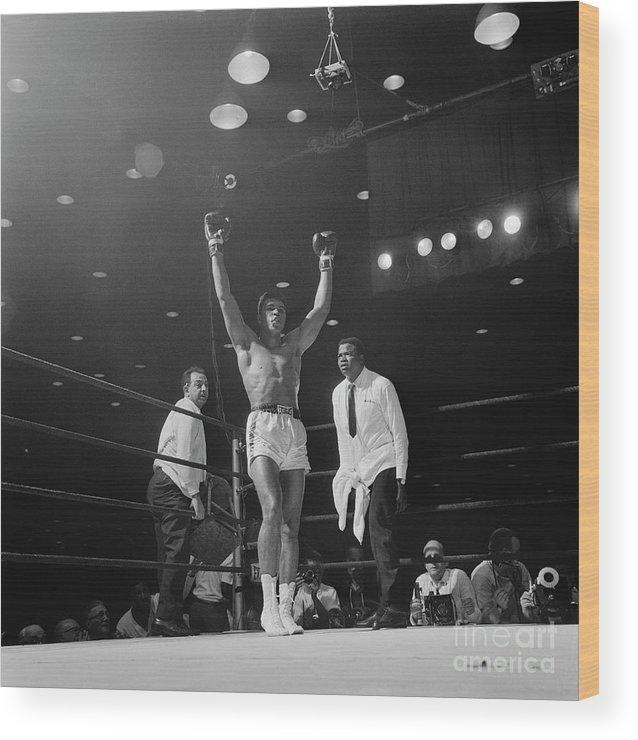 Human Arm Wood Print featuring the photograph Heavyweight Champion Muhammad Ali by Bettmann