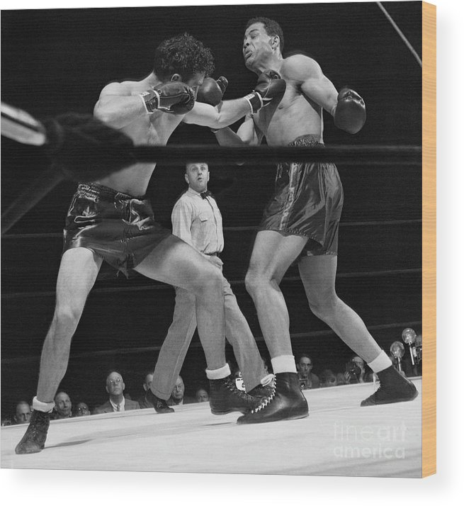 Mature Adult Wood Print featuring the photograph Joe Louis And Billy Conn In Boxing Match by Bettmann