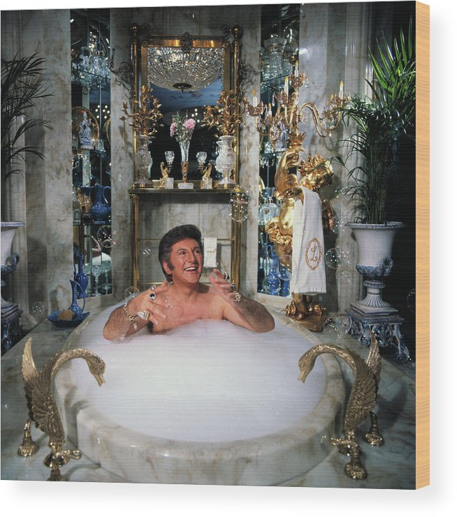 Mature Adult Wood Print featuring the photograph Liberace Taking A Bubble Bath by Bettmann