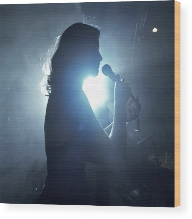 25-29 Years Wood Print featuring the photograph Silhouette Of Woman Using Microphone by Frank Herholdt