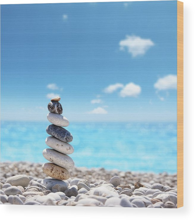 Water's Edge Wood Print featuring the photograph Stone Balance On Beach by Imagedepotpro