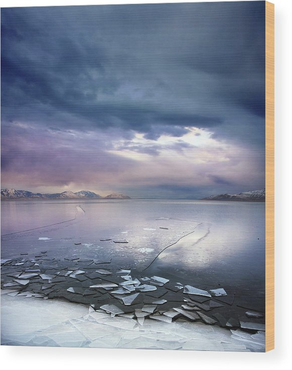 Scenics Wood Print featuring the photograph Storm Clouds Clearing Over Icy Lake by Utah-based Photographer Ryan Houston