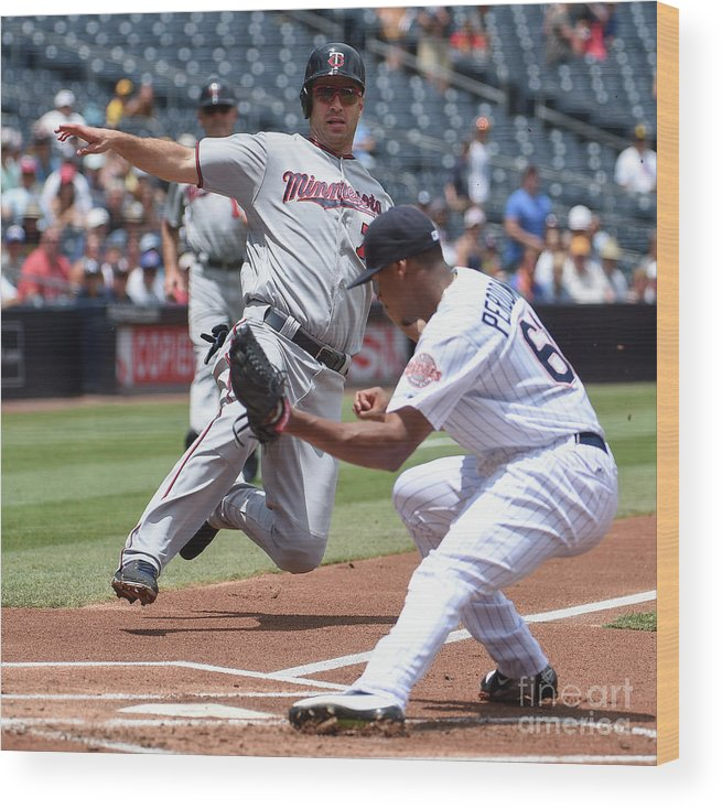 Joe Mauer Wood Print featuring the photograph Joe Mauer and Luis Perdomo by Denis Poroy