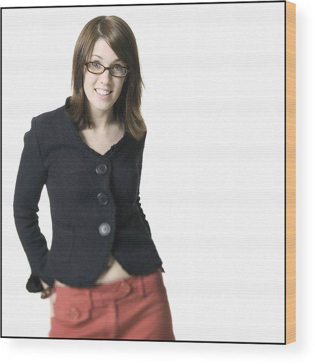 White Background Wood Print featuring the photograph Medium Shot Of A Young Adult Female In A Black Shirt And Glasses As She Smiles by Photodisc