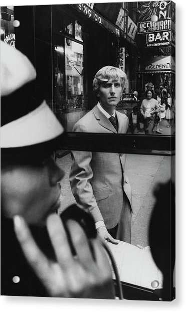 Woman In Telephone Booth Watched By Man Acrylic Print