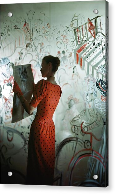 A Model Wearing A Polka Dot Dress Reading Acrylic Print by Constantin Joffe