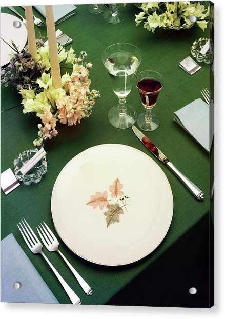 A Table Setting On A Green Tablecloth Acrylic Print