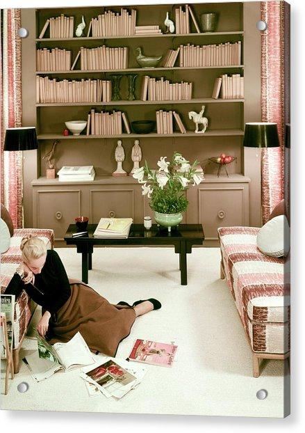 A Woman Reading Magazines On The Floor Acrylic Print