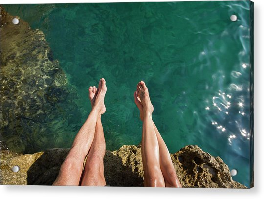 Couples Legs Above Turquoise Ocean Acrylic Print by Picturegarden