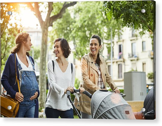 Happy Pregnant Woman With Friends In Park Acrylic Print by Morsa Images