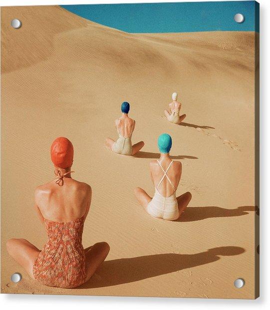 Models Sitting On Sand Dunes Acrylic Print