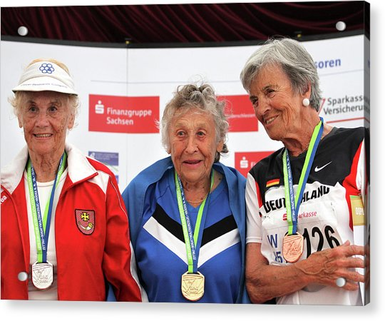 Older Female Athletes On Medals Rostrum Acrylic Print by Alex Rotas