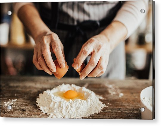 Woman Adds An Egg To The Flour Acrylic Print by Anchiy