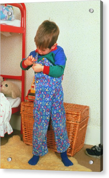 Young Child Adjusting His Dungarees Acrylic Print