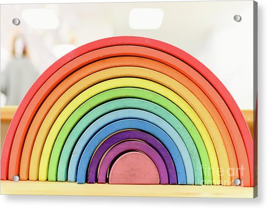 Colorful Waldorf Wooden Rainbow In A Montessori Teaching Pedagogy Classroom. Acrylic Print