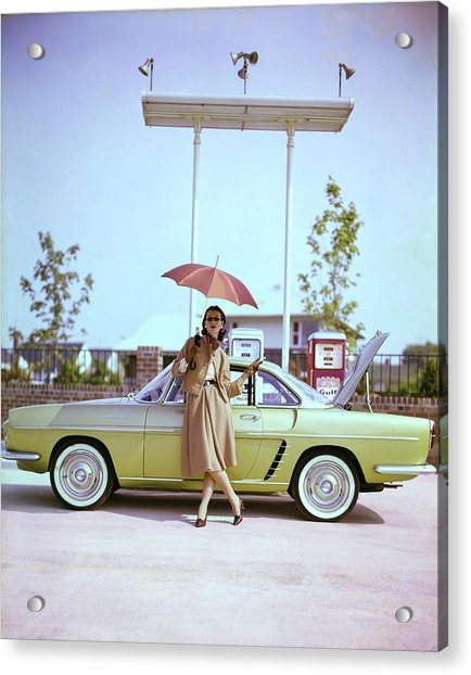 Model In Front Of A Gold Renault Caravelle Acrylic Print by Jerry Schatzberg
