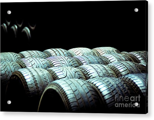 Old Tires And Racing Wheels Stacked In The Sun Acrylic Print
