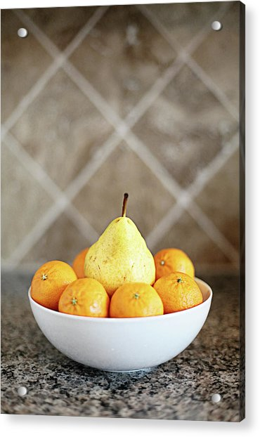 Pear Surrounded By Oranges In White Bowl Acrylic Print