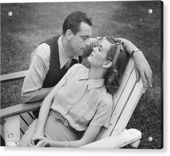 Romantic Couple Relaxing On Deckchair Acrylic Print