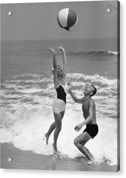 Young Couple Playing With Beach Ball At Acrylic Print