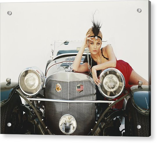 Young Woman Lying On Vintage Car Acrylic Print by Tom Kelley Archive