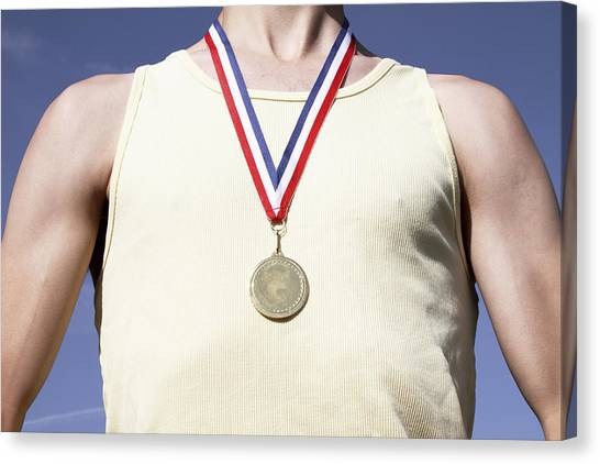 . Athlete With Gold Medal Canvas Print by Tom and Steve