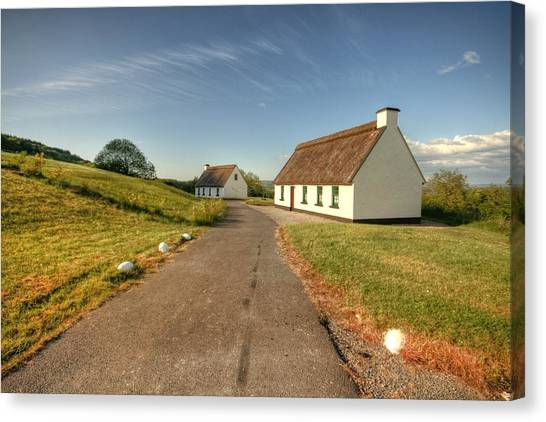 Corofin Thatched Cottages Canvas Print by John Quinn