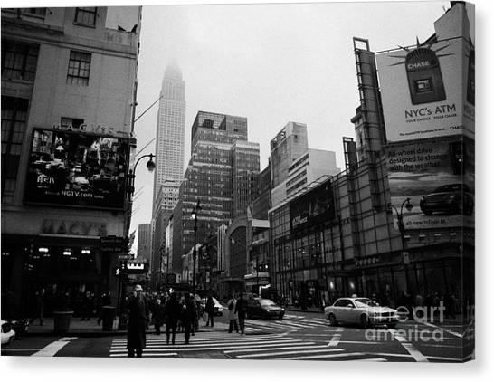 Pedestrians Crossing Crosswalk Outside Macys 7th Avenue And 34th Street Entrance New York City Canvas Print by Joe Fox