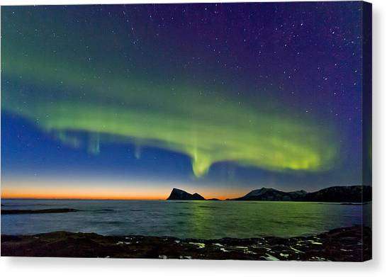Sunset And Aurora Oval Canvas Print