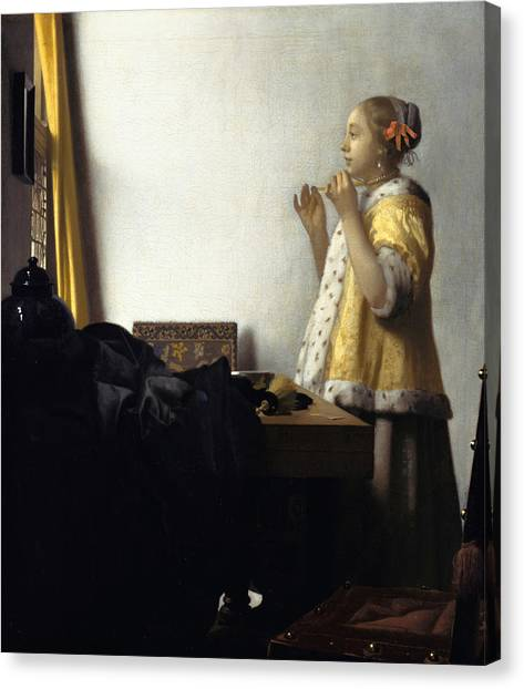 Young Woman With A Pearl Necklace Canvas Print by Johannes Vermeer