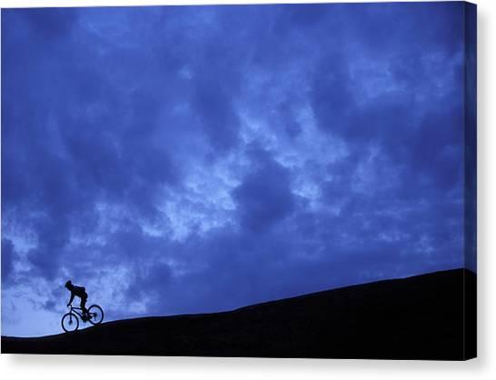It Professional Canvas Print - A Silhouette Of A Woman Mountain Biking by Corey Rich