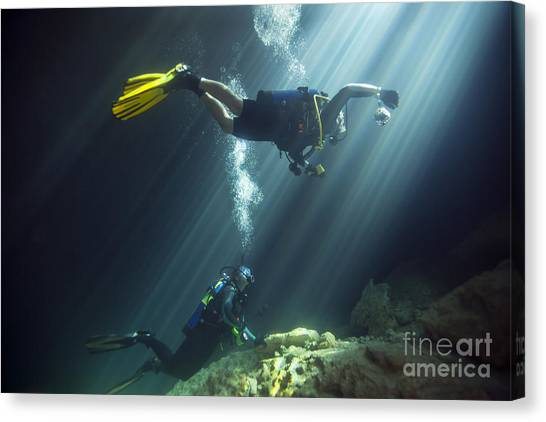 Underwater Caves Canvas Print - A Young Married Couple Scuba Diving by Michael Wood