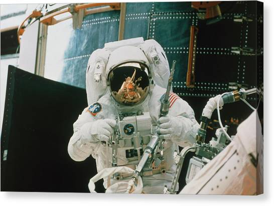 Space Shuttle Canvas Print - Astronaut Spacewalks To Repair Hubble Telescope by Nasa/science Photo Library