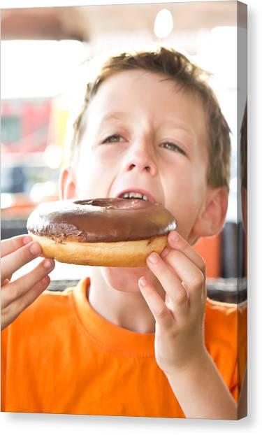 Doughnuts Canvas Print - Boy With Donut by Tom Gowanlock