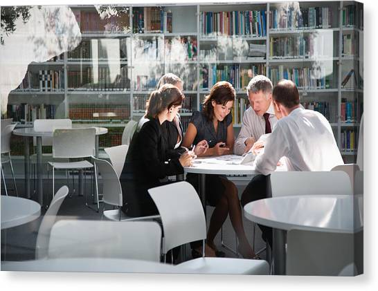 Businesspeople In Office Meeting Canvas Print by Tom Merton