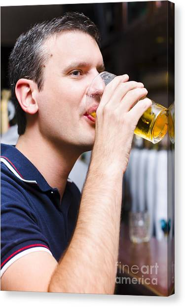 Tasting Canvas Print - Caucasian Man Drinking Pint Of Beer Inside Pub by Jorgo Photography - Wall Art Gallery