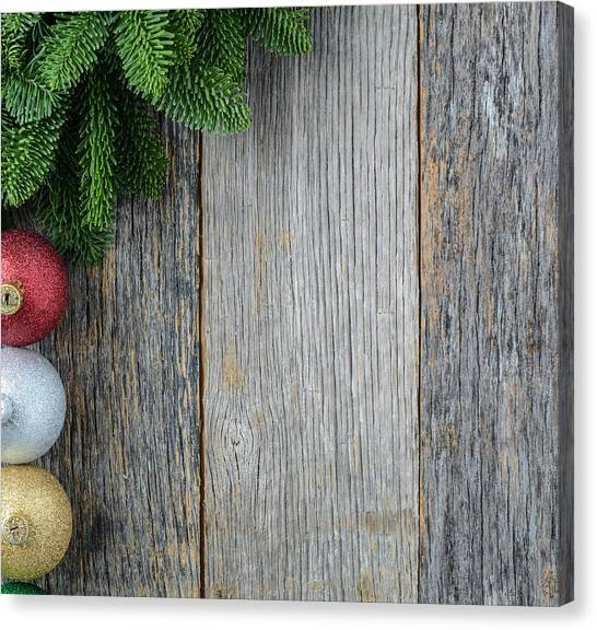 Christmas Pine Needle And Ornaments On A Rustic Wood Background Canvas Print