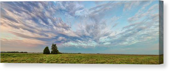 Sunrise Horizon Canvas Print - Clouds Over Landscape At Sunrise by Panoramic Images