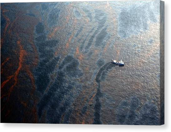 Coast Guard Attempts Burning Off Oil Leaking From Sunken Rig Canvas Print by Chris Graythen