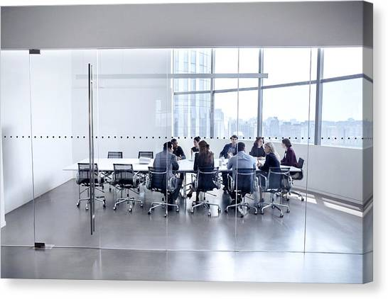 Colleagues At Business Meeting In Conference Room Canvas Print by FangXiaNuo