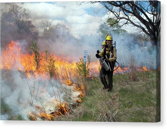 Protective Clothing Canvas Print - Controlled Fire by Jim West
