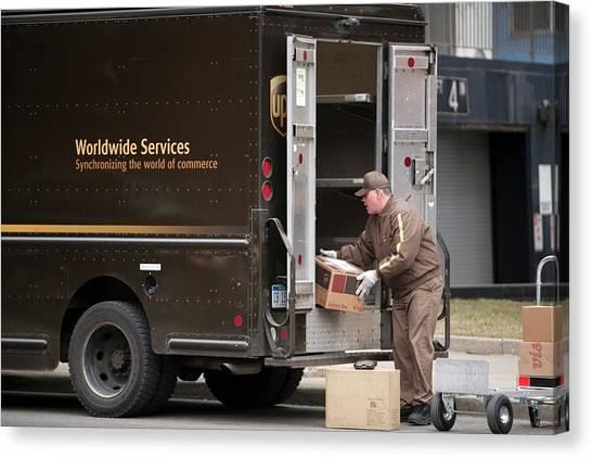 Truck Driver Canvas Print - Deliver Driver Loading His Van by Jim West